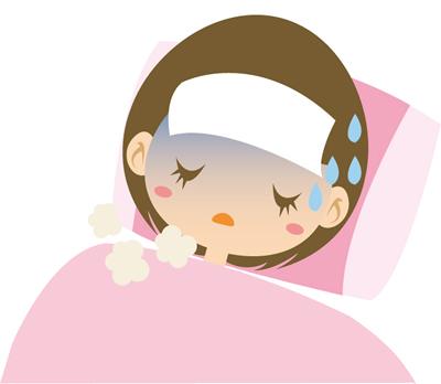 発熱で寝込む女性